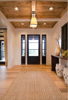Love the ceiling treatment of stained/painted and panels