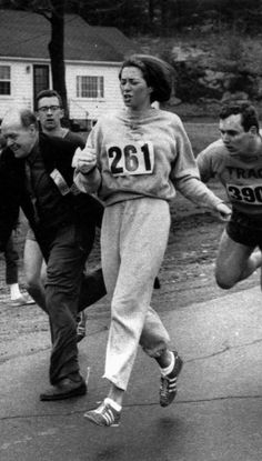 """Kathrine Switzer. In 1967 she was the first woman to run the Boston marathon. After realizing that a woman was running, race organizer Jock Semple went after Switzer shouting, """"Get the hell out of my race and give me those numbers."""" However, Switzer's boyfriend and other male runners created a human shield during the entire marathon.    The photograph taken of the incident made world headlines, and Kathrine later won the NYC marathon with a time of 3:07:29."""