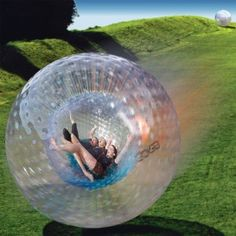 Zorbing. Been there, done that. :)