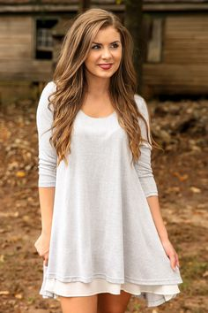 """Gather """"By The Fireside"""" and snuggle up close with a to cause a little more heat to radiate throughout the space! You will be sure to turn up the temperature in this simply haute t-shirt dress! You're sure to cause more than a few guys to wipe their brow as you bring the sizzle and the sweet!! Loose fitting dress features a scoop neckline, 3/4 length sleeves, and a lining on the front of the dress that extends past the hemline. Semi Lined. Sheer. 65% Cotton, 35% Polyester. Wash by hand in…"""