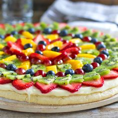 Sugar Cookie Fruit Pizza - This is so good! You don't feel as guilty eating the giant cookie with icing with all that fruit on top.