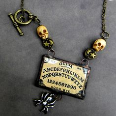 ouija with skulls | Ouija Board Necklace - Handcarved Skulls - Palmistry and Fortunes Told ...