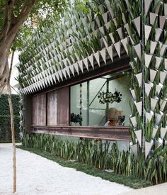 """Firma Casa Store / SuperLimão Studio + Campana Brothers Firma Casa redefines the """"gutter"""", as it features a living facade of over six thousand seedlings hanging in origami shaped aluminum vases that efficiently filter and drain rainwater from the roof. Architecture Durable, Architecture Design, Green Architecture, Facade Design, Sustainable Architecture, Amazing Architecture, Landscape Architecture, Landscape Design, Garden Design"""