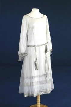 1927 Wedding Dress of ivory satin with silver...and apparently, in the days before Queen Victoria, most wedding gowns were silver, not white, which was started with her Royal Highness....  w.