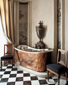 /\§/\ : Frédéric Méchiche : A pair of mahogany Jacob chairs flanks a copper tub in a bathroom.