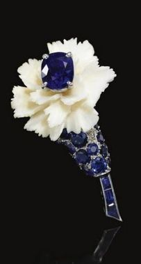 A sapphire, diamond, and ivory brooch in the form of a carnation was given to the nurse who took care of the Duke of Windsor until his death. He had the brooch made for her specifically and it was gifted to her by the Duchess following his death.
