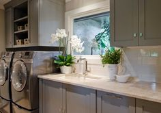 Elegant Laundry Room. Nice Sophisticated Touches.
