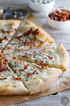 Change up your Friday night pizza with this Blue Cheese and Bacon Pizza. Pizza crust is topped with an easy béchamel sauce, bacon and blue cheese for a gourmet pizza at home. -some interesting flavors going on I Love Pizza, Good Pizza, Quiches, Blue Cheese Burgers, White Pizza Recipes, Bacon Pizza, Sandwiches, Pasta, Calzone