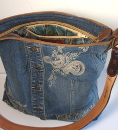 weekender bag from upcycled denim jacket and leather belt strap