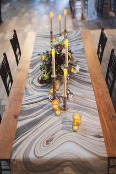 Gold accents stand out over a marble paper table runner.