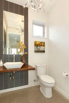 Contemporary Powder Room with Chandelier, Powder room, Wood counters, specialty door, Vessel sink, limestone floors
