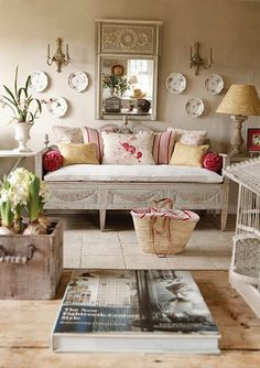 Love the bench with all the cushions, and the mirror. All Kate Forman