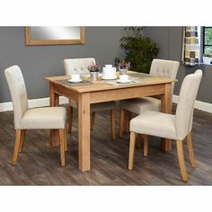 Dine in style with this contemporary Mobel Oak 4 to 6 seat dining table and grey chair set. The table is made from solid oak and the chairs are upholstered in cream linen fabric - perfect for a unique feel and look for your dining room. Oak Dining Sets, Dining Table Sizes, Oak Dining Table, Dining Table Design, Table And Chairs, Small Dining, Solid Oak Furniture, Oak Furniture House, Dining Furniture Sets