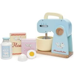 Honeybake Mixer Set by Le Toy Van - A delightful Mixer Set by Le Toy Van. This gorgeous wooden mixer has all the functionality of a real mixer. It has three speed settings, a removable bowl and the ability to raise the mixer to replace or remove the bowl Kids Role Play, Pretend Play, Wooden Toy Kitchen, Wooden Toys, Wooden Kitchens, Wooden Play Food, Baby Toys, Kids Toys, Toddler Toys