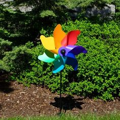 "12"" Rainbow Poly Petal Pinwheel Spinner.  12 inch Poly Petal Pinwheels are made with durable polypropylene material and come with a 22 inch fiberglass pole and ground stake. Poly Petal Pinwheels ship flat and are easy to assemble. #pinwheel #windspinner"