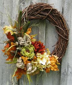 autumn wreath.... Repinnning here cuz I think I could make the flowers for this...hmmmm....