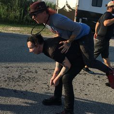 "icemftmm: "" Marilyn Manson giving Sid Wilson from Slipknot a piggy back ride, Wantagh, NY, 06.07.2016 """