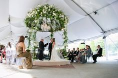 Breathtaking iron dome canopy with bright green ferns, white lilies and roses illuminated within by a sparkling crystal chandelier. Floral & Decor: http://KehoeDesigns.com, Photography: Swan Photography, Planning: Birch Design Studio, Venue: Tiffany Gardens & The Chicago Illuminating Company