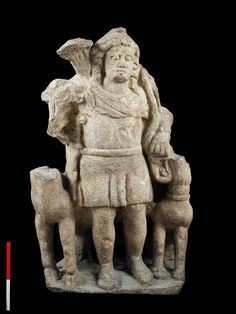 This male figure with cap, quiver, short tunic and dagger is thought to be a god of hunting.  A figure of a dog and, probably, a stag are at either side. The figure and its various elements mix together a variety of Greek or Roman and native British gods such as Diana, Apollo, Mithras, Attis, Sylvanus and Maponus.