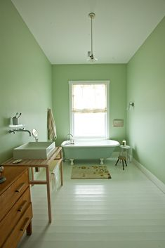 mint green bathroom with clawfoot tub and Nameek's Teorema sink   A Hilltop Cottage in Nova Scotia