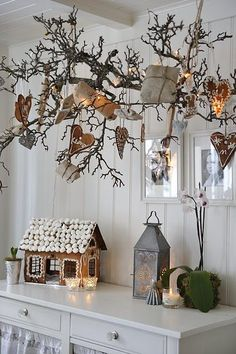make and arrangement of branches (maybe branches from a pine tree), hang from the ceiling and decorate with ornaments. Awesome if you have limited floor space or pets/kids who need to be kept out of a tree!