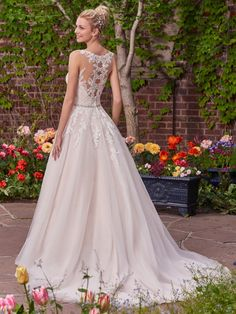 Rebecca Ingram - OLIVIA, A lace bodice and illusion bateau neckline add romance and enchantment to this tulle ballgown. A unique illusion lace back features cascading keyholes, while a Swarovski crystal-embellished belt adds a touch of sparkle. Finished with covered buttons over zipper closure.