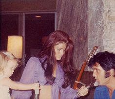 Candid Elvis with Priscilla | Lisa Marie, Priscilla and Elvis playing the piano sometime in 1969