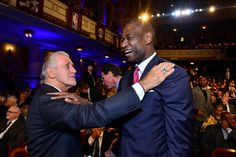 Inductee Dikembe Mutombo greets Pat Riley during the 2015 Basketball Hall of Fame Enshrinement Ceremony on September 11 2015 at the Naismith...