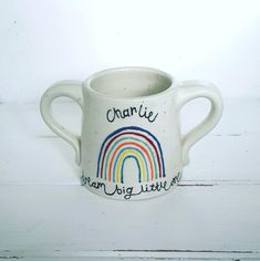 Personalised Rainbow Childrens Mug This sweet sentiment baby mug makes a fantastic christening, new arrival or birthday gift. The unisex rainbow mug will brighten up anyone's nursery and make the transition for bottle to skippy mug all the easier. Personalised Mugs, Personalized Gifts, Childrens Mugs, Christening, Birthday Gifts, Nursery, Handle, Rainbow, Hand Painted