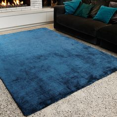 Tula Rugs in dark teal have a dense, soft pile and a sophisticated lustre and are a popular plain coloured range. This luxurious collection is handmade in China with a 15mm Polyester pile.