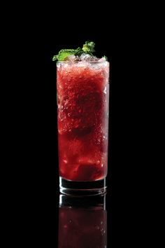 Santa Rosa     3 Luxardo cherries     1 oz. Cocchi Americano Rosa     1 oz. pisco     1 oz. Sorel hibiscus liqueur     ½ oz. lime juice     Absinthe, for garnish     Mint sprig, for garnish