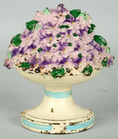 Vintage Cast Iron Violet Bowl Doorstop, Made by Hubley..... wooooow!!!! never seen one of these doorstops before......