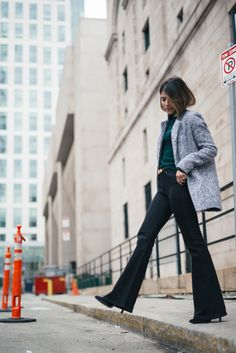 Pam Hetlinger, The Girl From Panama wearing a Topshop Funnel Neck Long Sleeve Top, Mango Flare Jeans, and Gray Coat.