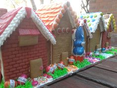 Easter...Gingerbread Row Houses. Texture in gingerbread made using Fondant Impression Mats.  I got mine here; http://www.ebay.com.au/itm/121591859123?_trksid=p2057872.m2749.l2649&ssPageName=STRK%3AMEBIDX%3AIT