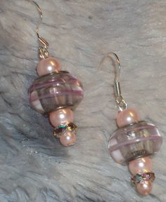 Handcrafted Pink Glass Pearls with Glass Pink Striped Bead accented with Crystal in Silver Drop Earrings by JewelryByTracyO on Etsy