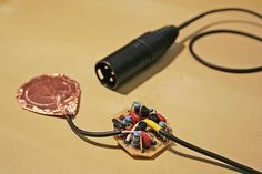 """Alex Rice Piezo Preamp: Assembled A small amplifier designed to develop a nice, balanced, signal from a generic Piezo disk. In his words: """"A phantom-powered preamplifier that provides a balanced, buffered output from a lowly piezo disc"""""""