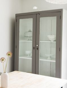 A dining room cabinet in Farrow Ball Mole's Breath by Tina Fussell of Traveling Mama blog