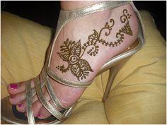 Mehndi designs on feet.