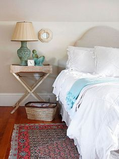 A neutral color palette makes for a calm master bedroom retreat. Plus, the light colors create the illusion of more space in tight quarters. To avoid neutral overload, introduce a few colorful accessories. Here, a turquoise lamp does the trick. Wicker Shelf, Wicker Table, Wicker Furniture, Wicker Couch, Wicker Mirror, Wicker Dresser, Wicker Trunk, Wicker Planter, Wicker Baskets