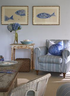 Beach cottage in Fairfield, CT, designed by Lynn Morgan. Photographer: Jeff McNamara.  ~  blue white stripes nautical living dining room wicker weathered distressed chippy shabby chic