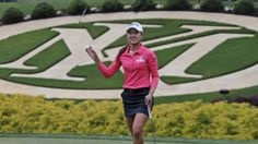 Minjee Lee tips her ball to the crowd after she parred the 18th hole to win the rain-delayed Kingsmill Championship  LPGA golf tournament, May 18, 2015