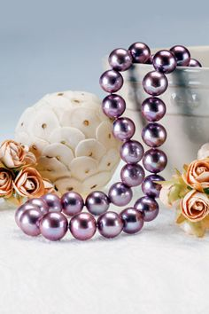 These pearls are to die for! The lilac color is rich and more importantly, natural. Yes, this beautiful color is all natural and just look at that luster! We've never seen anything like it. Perfect for any June birthday or wedding!   11.5-13.5mm Lilac Cultured Freshwater Pearl 14k Yellow Gold 18 Inch Necklace