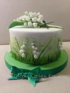"A handpainted 6"" Caraway seed cake with sugar paste Lily of the Valley flowers"