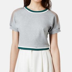 """topshop]grey crop top w mesh shoulders & crew neck Such the perfect crop top to wear with joggers or high-waisted bottoms. You can also dress up with white quilted skirt for a look that is comfy yet polished. This top looks great on and falls v nicely on the body. On our size 0-2 frame, it's neither too tight nor loose. Our pics are 2,3,&4. Grey see-through mesh shoulders and striped green crew neck and waist. 64/31/5: viscose/nylon/elastane. 14 3/4"""" shoulder to hem, 14"""" wide. Some stretch…"""