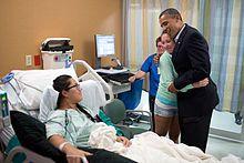 Barack Obama - President Obama visiting victims of a shooting at University of Colorado Hospital on July 22, 2012