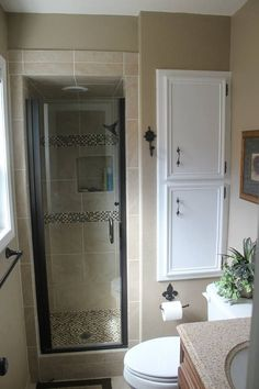 I am in love with this bathroom. Love the tile around the shower and love the cabinet by the toilet. And the plant! Love it all. #Christmas #thanksgiving #Holiday #quote