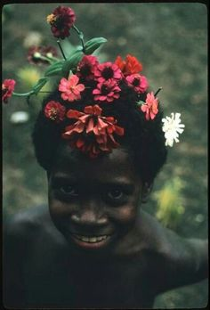 A young Kwaio boy wearing traditional flower adornment in Malatai, The Solomon Islands, 1970