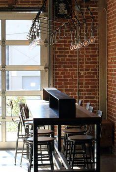 Studio Unltd designed meat-hook inspired lighting over the communal tables at Bestia