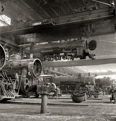 "March 1943. Albuquerque, New Mexico. ""An engine being carried to another part of the Atchison, Topeka & Santa Fe railroad shops to be wheeled."" Photo by Jack Delano for the Office of War Information.  http://www.shorpy.com/node/16295"