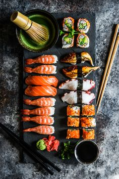 Sushi and sashimi variety on rustic background by Alena Haurylik - Photo 175772427 / 500px